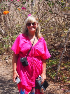 Pam demonstrating Union Island's bouganvillia matches her top
