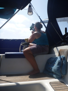 Erica using Susie's sextant to take a sun sight
