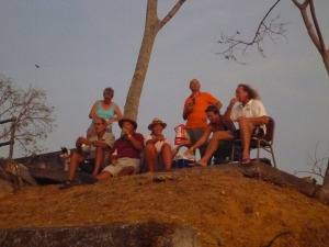 The crews of Amarula, Star Charger and Temptress celebrate a successful sloth hunt with sundowners at the top of Isla Flamenco