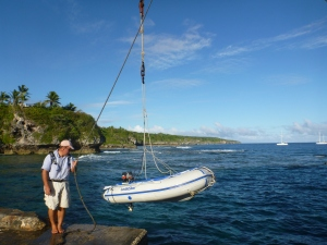 Lifting out the dinghy at Alofi