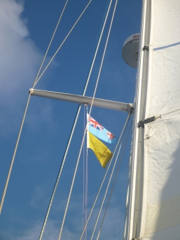 Fiji and Q flag hoisted off Oneata Passage